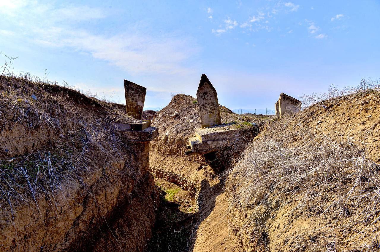 Armenian military trench found dug between graves in Azerbaijan's Aghdam
